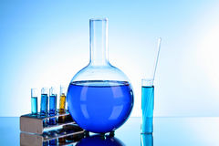 Test tubes and flask. On blue background Stock Photo