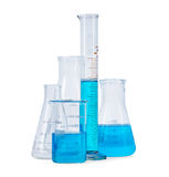 Test-tubes, flasks with blue liquid Royalty Free Stock Photos