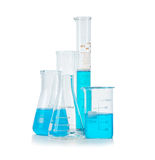 Test-tubes, flasks with blue liquid isolated Stock Photography