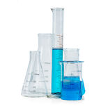 Test-tubes, flasks with blue liquid isolated Stock Images