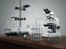 Test tubes with laboratory equipment and microscope on the table Stock Images