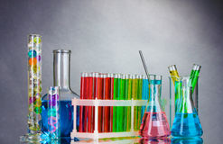 Test-tubes with liquid on gray Royalty Free Stock Photography