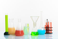 Test-tubes with liquid on light background Royalty Free Stock Photography