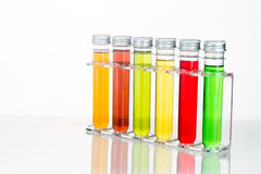 Test tubes with multi color chemicals  in white Royalty Free Stock Photo