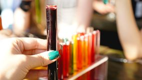 Test tubes with multi-colored liquid. Alcohol in test tubes dark bar stock photo
