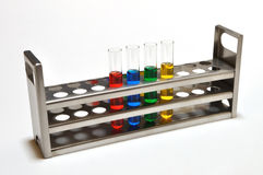 Test Tubes in Rack. Photograph of test tubes in metal test tube rack Royalty Free Stock Photography