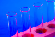 Test tubes in red and blue. Laboratory test tubes in a stand in bright red and blue Royalty Free Stock Photography