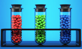 Test tubes with red, green and blue spheres. Test tube with red, green and blue spheres on blue background. 3d illustration Stock Image