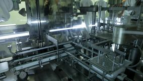 Test tubes on robotic conveyor. stock footage