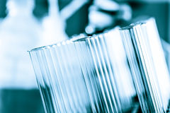 Test tubes. Science test background blue solutions test tubes Royalty Free Stock Images
