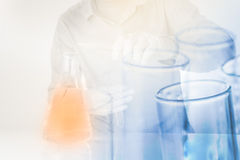 Test tubes in scientist hand with pour chemicals in flask Stock Photography