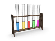 Test-tubes in wooden container with colorful fluid  on white Royalty Free Stock Photos