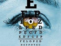 Test vision chart female eye macro. Test vision chart on female eye macro Stock Photography
