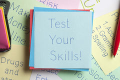 Test Your Skills written on a note. Top view of Test Your Skills written on a note with a pen aside royalty free stock photos