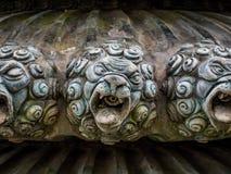Testa bronzea di un leone Fotografie Stock