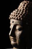 Testa del Buddha isolata su priorità bassa nera Immagini Stock Libere da Diritti