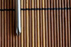 Testa della bocca della stella del cacciavite su fondo di legno, cacciavite della Stella-lama Immagini Stock
