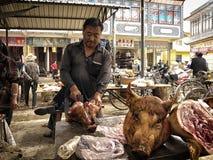 Testa della carne di maiale di taglio di Burcher Immagine Stock Libera da Diritti