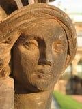 Testa della donna di pietra della sabbia all'indicatore luminoso dorato Fotografia Stock Libera da Diritti