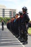 Testa della polizia di tumulto allineata Fotografie Stock Libere da Diritti