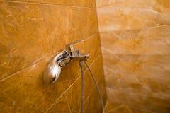 Testa di doccia nel bagno Immagine Stock