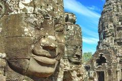 Testa di pietra sulle torrette del tempiale di Bayon Immagini Stock