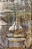 Testa di pietra sulle torrette di Bayon Immagini Stock