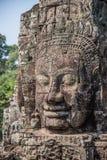 Testa di pietra sulle torri del tempio di Bayon a Angkor Thom, Cambogia. S Immagini Stock Libere da Diritti