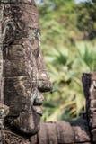 Testa di pietra sulle torri del tempio di Bayon a Angkor Thom, Cambogia. S Fotografia Stock Libera da Diritti