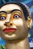 Testa dorata della donna a Bangkok immagini stock