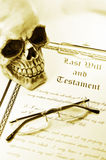 Testament. Last will and testament with skull and glasses in sepia monochrome Stock Photo