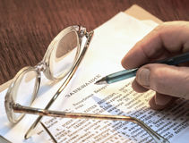 Testament on cream color paper with glasses. Last will and testament on cream color paper with glasses Royalty Free Stock Photo