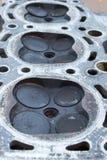 Testata consumata con quattro valvole per cilindro Fotografie Stock