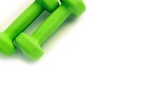 Teste di legno verdi per forma fisica isolate su fondo bianco Fotografia Stock