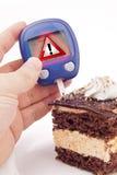 Teste do açúcar no sangue com sinal de aviso Imagens de Stock Royalty Free
