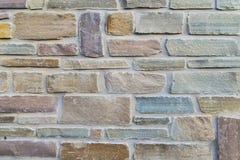 Teste padrão áspero colorido dos tijolos Fotografia de Stock Royalty Free