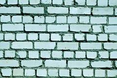 Teste padrão áspero tonificado ciano da parede de tijolo foto de stock