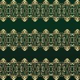 Teste padrão abstrato do ouro em um fundo verde Fotos de Stock