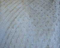 Teste padrão abstrato em um fundo concreto imagens de stock
