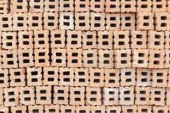 Teste padrão alaranjado do tijolo para construir Foto de Stock