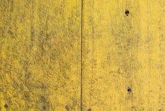 Teste padrão amarelo na porta Imagem de Stock