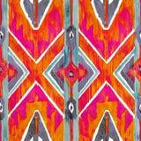 Teste padrão autêntico vermelho de Ikat e alaranjado geométrico no estilo do watercolour Aquarela sem emenda fotos de stock royalty free