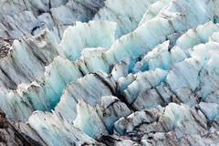 Teste padrão azul da textura do fundo do gelo da geleira Imagens de Stock Royalty Free