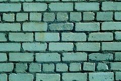 Teste padrão ciano áspero velho da parede de tijolo da cor fotografia de stock royalty free
