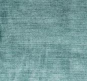 Teste padrão ciano das calças de brim da cor foto de stock royalty free
