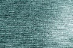 Teste padrão ciano de pano da sarja de Nimes foto de stock