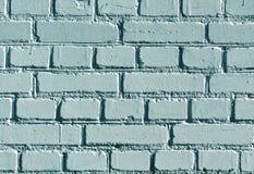 Teste padrão ciano resistido da parede de tijolo da cor fotos de stock