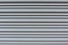 Teste padrão cinzento horizontal da listra do metal Fotos de Stock Royalty Free