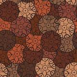 Teste padrão circular, tribal em tons marrons com motivos do tribos africanos Surma e Mursi Foto de Stock