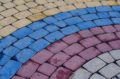 Teste padrão Cobbled do pavimento feito dos cubos Foto de Stock